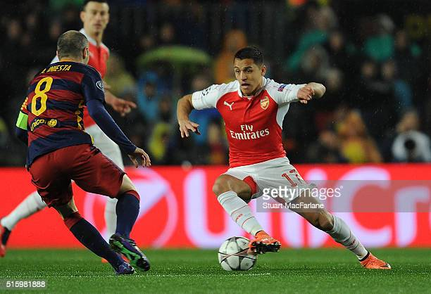 Alexis Sanchez of Arsenal takes on Andres Inesta of Barcelona during the UEFA Champions League Round of 16 2nd Leg match between Barcelona and...