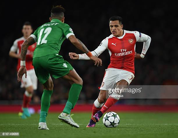 Alexis Sanchez of Arsenal takes on Anicet Abel of PFC Ludogorets Razgrad during the UEFA Champions League match between Arsenal FC and PFC Ludogorets...