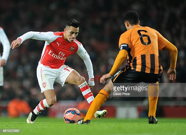 Alexis Sanchez of Arsenal takes on Curtis Davies of Hull City during the match between Arsenal and Hull City in the FA Cup 3rd Round at Emirates...