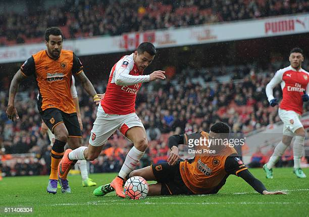 Alexis Sanchez of Arsenal takes on Curtis Davies of Hull during the match between Arsenal and Hull City in the FA Cup 5th Round at Emirates Stadium...