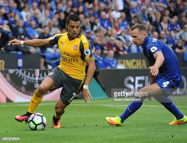 Alexis Sanchez of Arsenal takes on Danny Drinkwater of Leicester during the Premier League match between Leicester City and Arsenal at The King Power...