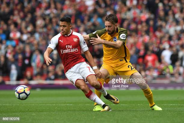 Alexis Sanchez of Arsenal takes on Davy Propper of Brighton during the Premier League match between Arsenal and Brighton and Hove Albion at Emirates...