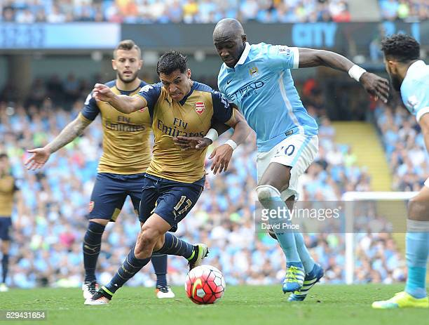 Alexis Sanchez of Arsenal takes on Eliaquim Mangala of Man City during the Barclays Premier League match between Manchester City and Arsenal at The...