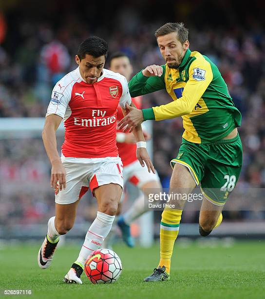 Alexis Sanchez of Arsenal takes on Gary O'Neil of Norwich during the Barclays Premier League match between Arsenal and Norwich City at on April 30th...
