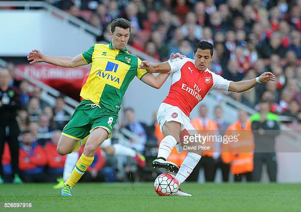 Alexis Sanchez of Arsenal takes on Jonny Howson of Norwich during the Barclays Premier League match between Arsenal and Norwich City at on April 30th...