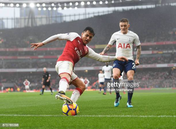 Alexis Sanchez of Arsenal takes on Kieran Trippier of Tottenham during the Premier League match between Arsenal and Tottenham Hotspur at Emirates...