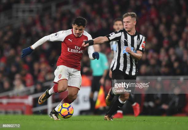 Alexis Sanchez of Arsenal takes on Matt Ritchie of Newcastle during the Premier League match between Arsenal and Newcastle United at Emirates Stadium...