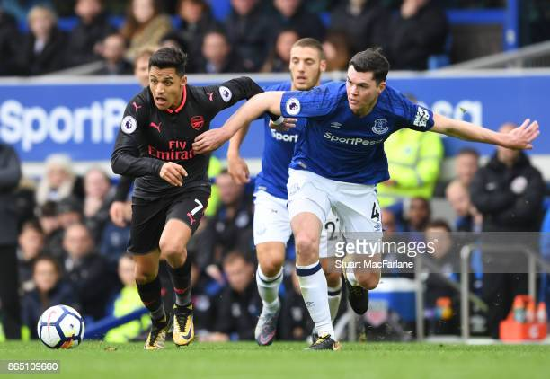 Alexis Sanchez of Arsenal takes on Michael Keane of Everton during the Premier League match between Everton and Arsenal at Goodison Park on October...