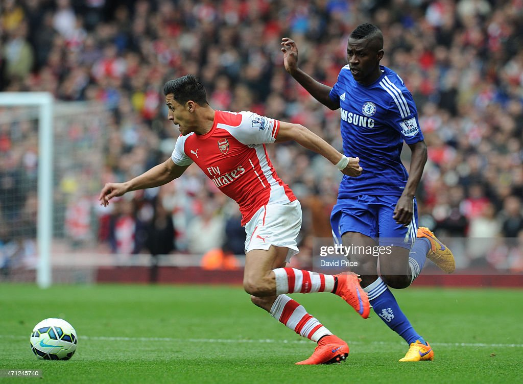 Alexis Sanchez of Arsenal takes on Ramires of Chelsea during the match between Arsenal and Chelsea in the Barclays Premier League at Emirates Stadium on April 26, 2015 in London, England.