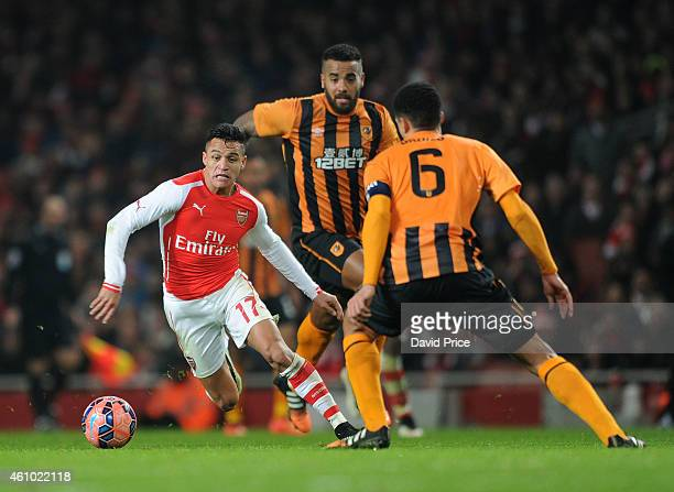 Alexis Sanchez of Arsenal takes on Tom Huddlestone and Curtis Davies of Hull City during the match between Arsenal and Hull City in the FA Cup 3rd...