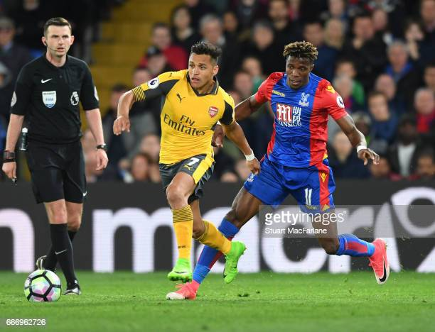 Alexis Sanchez of Arsenal takes on Wilfred Zaha of Crystal Palace during the Premier League match between Crystal Palace and Arsenal at Selhurst Park...