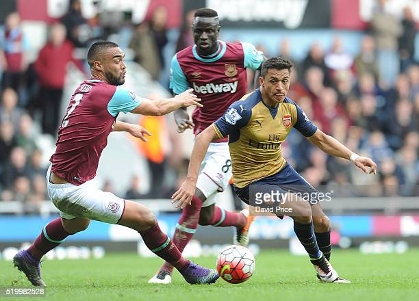Alexis Sanchez of Arsenal takes on Winston Reid of West Ham during the Barclays Premier League match between West Ham United and Arsenal at The...