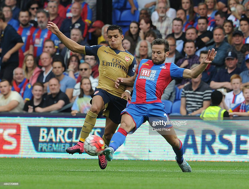 Alexis Sanchez of Arsenal takes on Yohan Cabaye of Crystal Palace during the Barclays Premier League match between Crystal Palace and Arsenal on August 16, 2015 in London, United Kingdom.