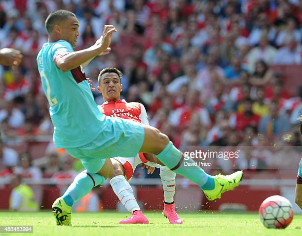 Alexis Sanchez of Arsenal under pressure from Winston Reid of West Ham during the Barclays Premier League match between Arsenal and West Ham United at