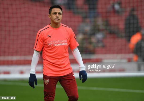 Alexis Sanchez of Arsenal warms up in an Arsenal Foundation tshirt before the Premier League match between Arsenal and Newcastle United at Emirates...