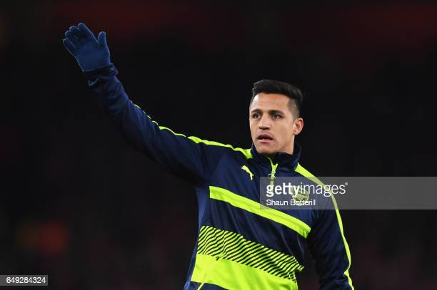 Alexis Sanchez of Arsenal waves as he warms up prior to the UEFA Champions League Round of 16 second leg match between Arsenal FC and FC Bayern...
