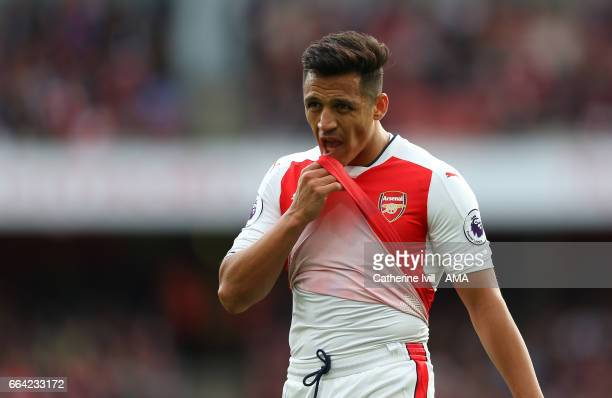 Alexis Sanchez of Arsenal wipes his face during the Premier League match between Arsenal and Manchester City at Emirates Stadium on April 2 2017 in...
