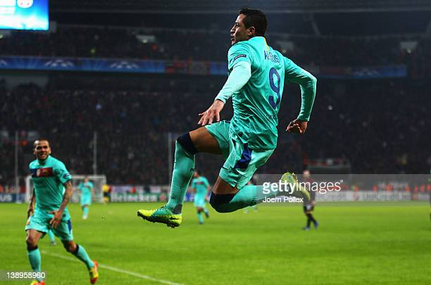 Alexis Sanchez of Barcelona celebrates after scoring his team's second goal during the UEFA Champions League round of sixteen first leg match between...