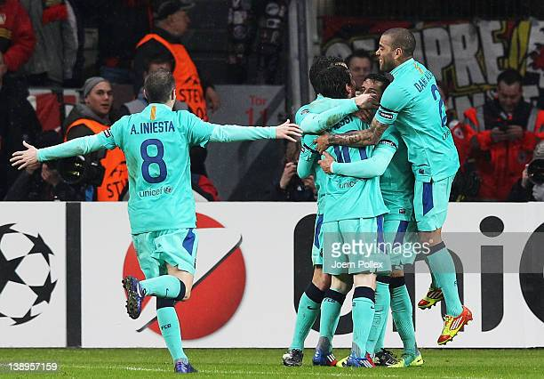 Alexis Sanchez of Barcelona celebrates with his team mates after scoring his team's first goal during the UEFA Champions League round of sixteen...