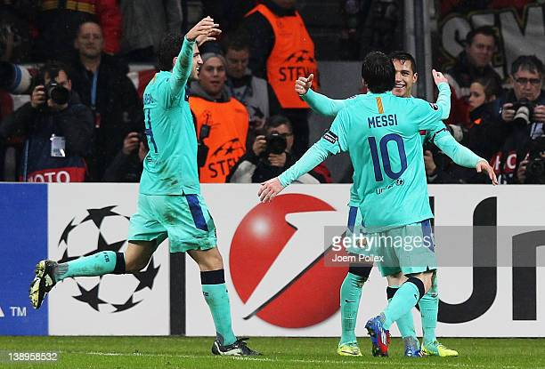 Alexis Sanchez of Barcelona celebrates with his team mates Lionel Messi and Cesc Fabregas after scoring his team's first goal during the UEFA...