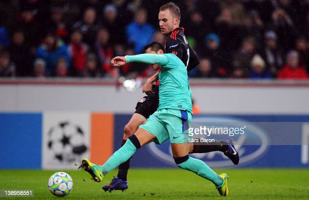 Alexis Sanchez of Barcelona scores his teams first goal against Michal Kadlec of Leverkusen during the UEFA Champions League round of 16 first leg...