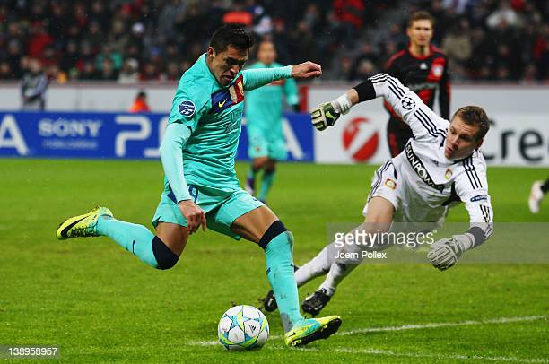 Alexis Sanchez of Barcelona scores his team's second goal during the UEFA Champions League round of sixteen first leg match between Bayer 04...