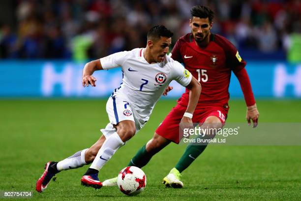 Alexis Sanchez of Chile and Andre Gomes of Portugal in action during the FIFA Confederations Cup Russia 2017 SemiFinal between Portugal and Chile at...