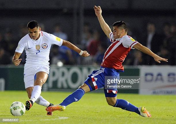 Alexis Sanchez of Chile and Jorge Moreira of Paraguay fight for the ball during a match between Paraguay and Chile as part of FIFA 2018 World Cup...