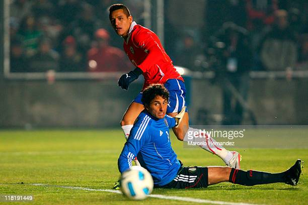 Alexis Sanchez of Chile battles for the ball against Luis Michel during a match as part of group C of 2011 Copa America at Bicentenarium Stadium on...