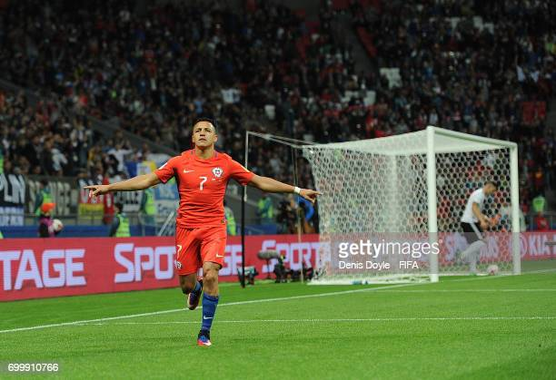 Alexis Sanchez of Chile celebrates after scoring his team's opening goal during the Group B FIFA Confederation Cup match between Germany and Chile at...