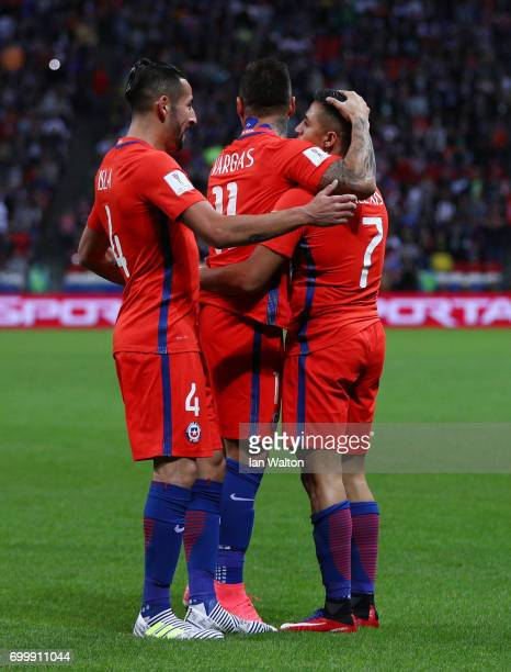 Alexis Sanchez of Chile celebrates scoring his sides first goal with Mauricio Isla of Chile and Eduardo Vargas of Chile during the FIFA...