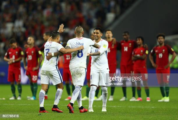 Alexis Sanchez of Chile celebrates scoring his sides third penalty with Arturo Vidal of Chile and Gonzalo Jara of Chile during the FIFA...