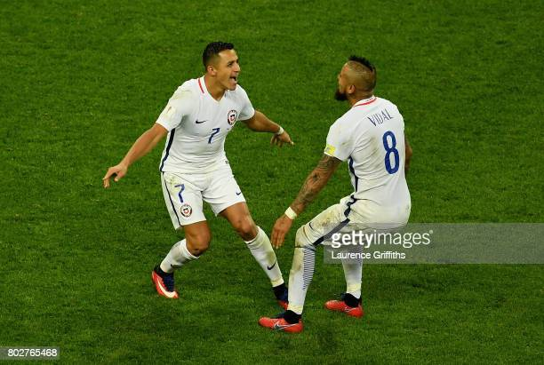 Alexis Sanchez of Chile celebrates scoring his side's third penalty with Arturo Vidal in the penalty shootout during the FIFA Confederations Cup...