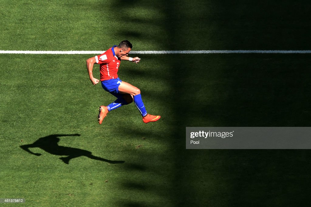 Alexis Sanchez of Chile celebrates scoring his team's first goal during the 2014 FIFA World Cup Brazil round of 16 match between Brazil and Chile at Estadio Mineirao on June 28, 2014 in Belo Horizonte, Brazil.