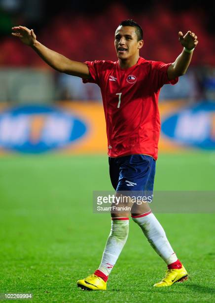 Alexis Sanchez of Chile celebrates the opening goal by Mark Gonzalez during the 2010 FIFA World Cup South Africa Group H match between Chile and...