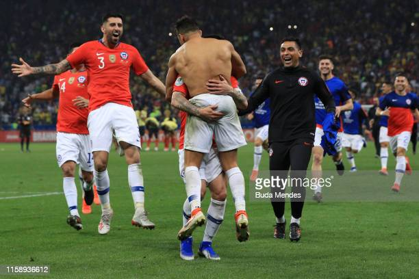 Alexis Sanchez of Chile celebrates with teammates after scoring the winning penalty during a shootout after the Copa America Brazil 2019 quarterfinal...