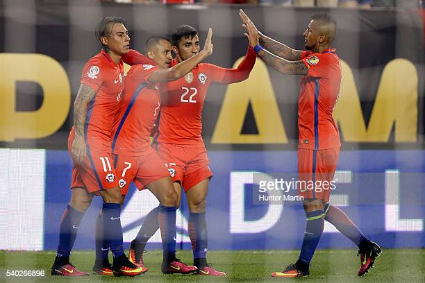 Alexis Sanchez of Chile celebrates with teammates after scoring the fourth goal of his team during a group D match between Chile and Panama at...