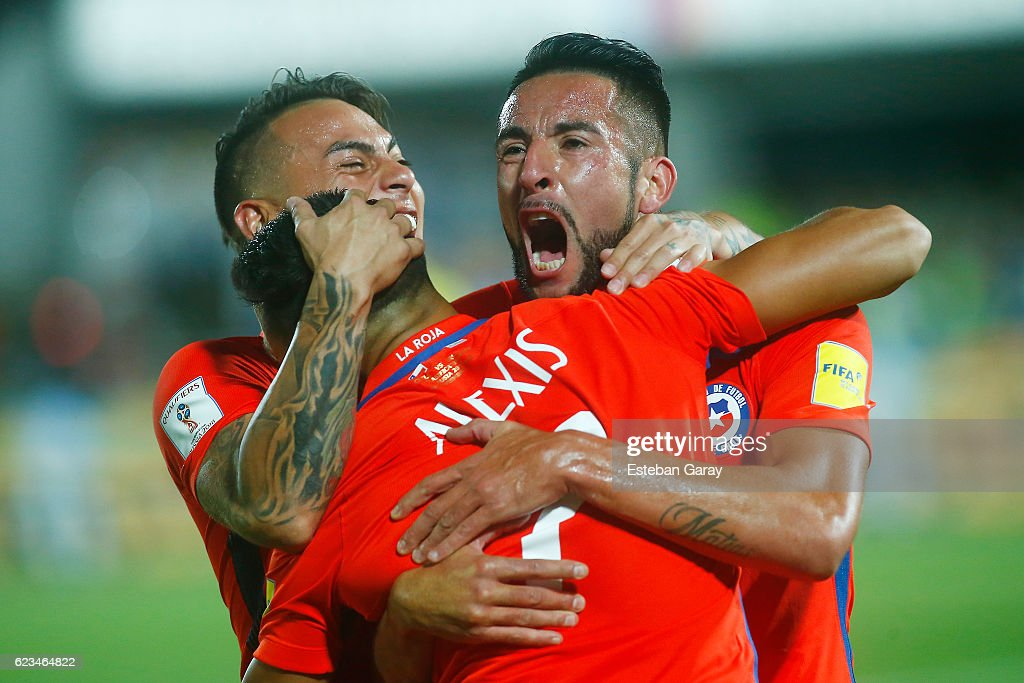 Alexis Sanchez of Chile celebrates with teammates after scoring the second goal of his team during a match between Chile and Uruguay as a part of FIFA 2018 World Cup Qualifier at Nacional Julio Martinez Pradanos Stadium on November 15, 2016, in Santiago, Chile.