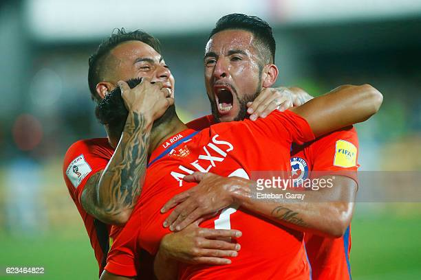 Alexis Sanchez of Chile celebrates with teammates after scoring the second goal of his team during a match between Chile and Uruguay as a part of...