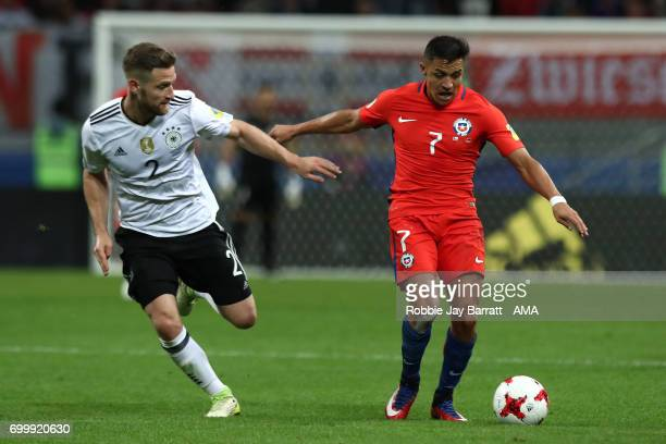 Alexis Sanchez of Chile competes with Shkodran Mustafi of Germany during the FIFA Confederations Cup Russia 2017 Group B match between Germany and...