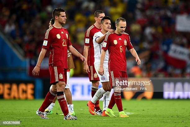 Alexis Sanchez of Chile consoles Andres Iniesta of Spain after the 2014 FIFA World Cup Brazil Group B match between Spain and Chile at Estadio...