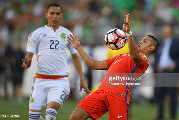 Alexis Sanchez of Chile controls the ball off his chest in front of Paul Aguilar of Mexico during the 2016 Copa America Centenario Quarterfinals...