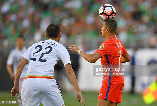 Alexis Sanchez of Chile controls the ball off his head in front of Paul Aguilar of Mexico during the 2016 Copa America Centenario Quarterfinals match...