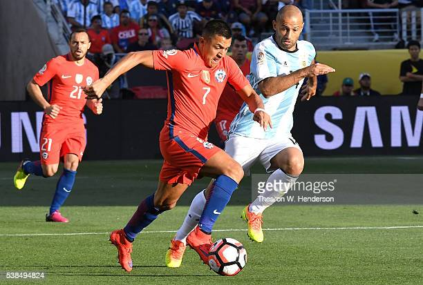 Alexis Sanchez of Chile dribbles the ball away from Javier Mascherano of Argentina during the 2016 Copa America Centenario Group match play between...