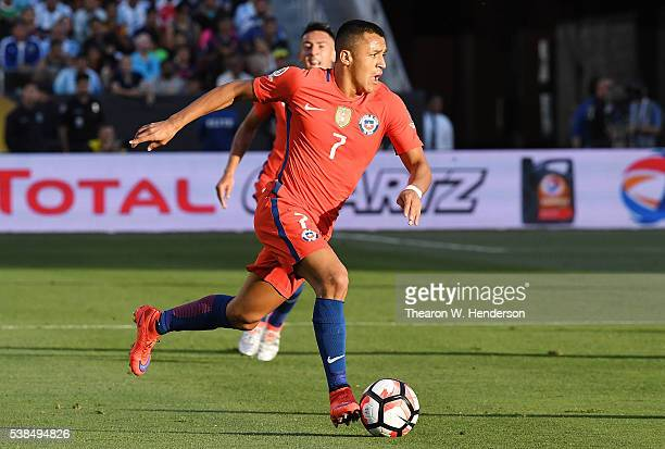 Alexis Sanchez of Chile dribbles the ball up field against Argentina during the 2016 Copa America Centenario Group match play between Argentina and...