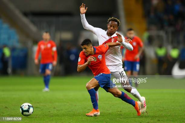 Alexis Sanchez of Chile fights for the ball with Andre Carrillo of Peru during the Copa America Brazil 2019 Semi Final match between Chile and Peru...