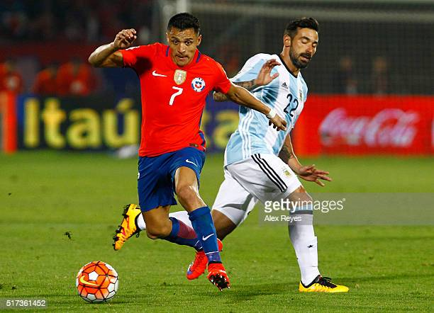Alexis Sanchez of Chile fights for the ball with Ezequiel Lavezzi of Argentina during a match between Chile and Argentina as part of FIFA 2018 World...