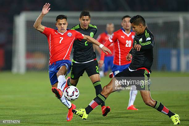 Alexis Sanchez of Chile fights for the ball with Hugo Ayala of Mexico during the 2015 Copa America Chile Group A match between Chile and Mexico at...