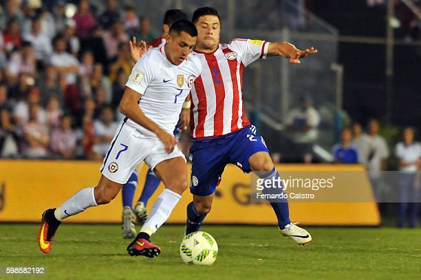 Alexis Sanchez of Chile fights for the ball with Jorge Moreira of Paraguay during a match between Paraguay and Chile as part of FIFA 2018 World Cup...