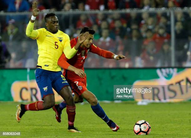 Alexis Sanchez of Chile fights for the ball with Renato Ibarra of Ecuador during a match between Chile and Ecuador as part of FIFA 2018 World Cup...